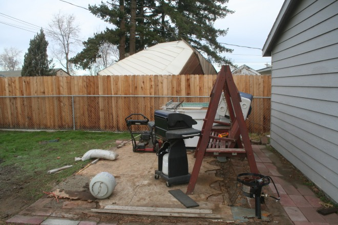 These items were once stored in the shed. The shed is behind the fence.
