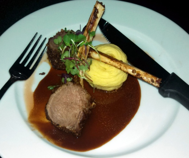 sixth course - Lamb crusted with pepitas, with black current veal jus and potato croquette. Paired with 2009 Onyx